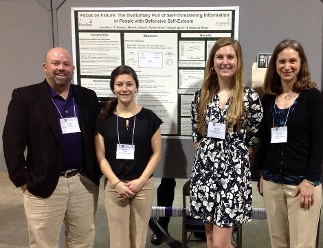 Professor Mark Oakes (St. Lawrence U), Becca Rees '16, Abby Quirk '16, and Professor Jennifer Borton at the meeting of the Society for Personality and Social Psychology; Long Beach, CA; Feb. 2015